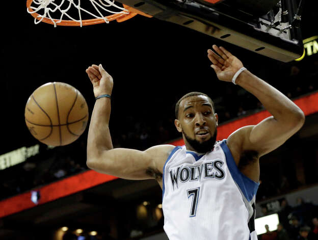 Minnesota Timberwolves' Derrick Williams slams in two of his game 13 points in the second half of an NBA basketball game against the San Antonio Spurs Tuesday, March 12, 2013, in Minneapolis. The Timberwolves won 107-83. Photo: Jim Mone, Associated Press / AP