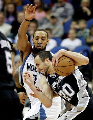 San Antonio Spurs' Manu Ginobili of Argentina, right, drives around Minnesota Timberwolves' Derrick Williams in the second half of an NBA basketball game Tuesday, March 12, 2013, in Minneapolis. The Timberwolves won 107-83. Photo: Jim Mone, Associated Press / AP