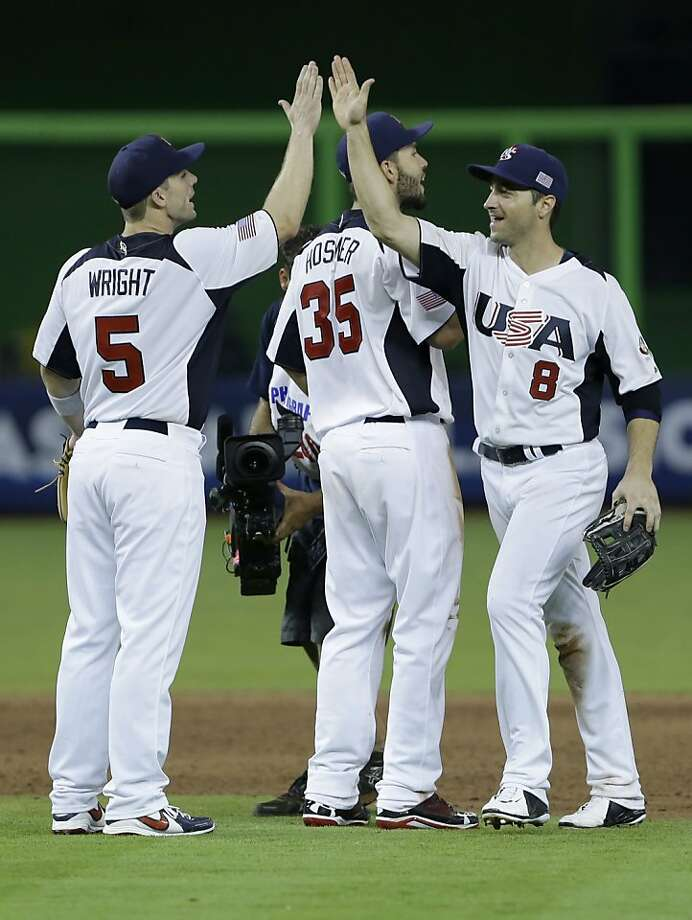 United States' David Wright (5) celebrates with Ryan Braun (8) and Eric Hosmer (35) after the U.S. defeated Puerto Rico 7-1 in a second round World Baseball Classic game, Tuesday, March 12, 2013 in Miami. Photo: Wilfredo Lee, Associated Press