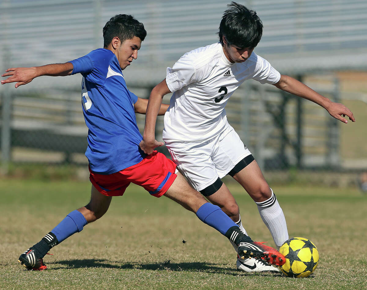 Mustang defender Ismael Rodriguez reaches in to tackle Daniel Jaramillo as Jefferson beats Edison 1-0 in soccer at the SAISD Spring Sports Complex on March 12, 2013.
