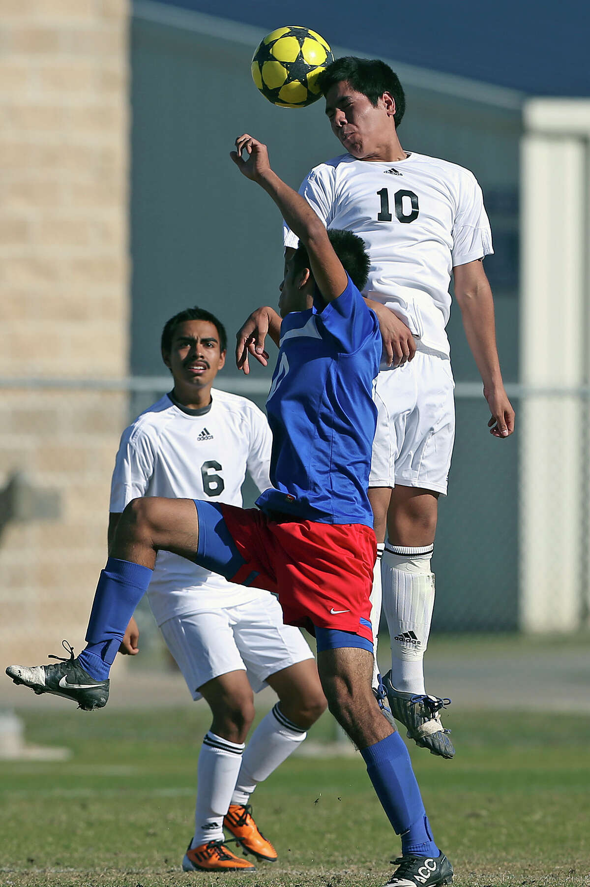 Edison's Andres Godina goes up for a header as Jefferson beats Edison 1-0 in soccer at the SAISD Spring Sports Complex on March 12, 2013.