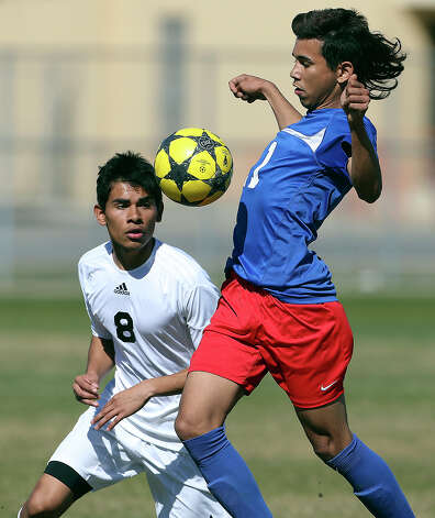 Jorge Cerrato controls against the Bears' Erik Monteagudo as Jefferson beats Edison 1-0 in soccer at the SAISD Spring Sports Complex on March 12, 2013. Photo: Tom Reel, San Antonio Express-News