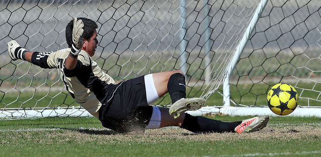 Bears' goalkeeper Fernando Delgado blocks a shot with his heel as Jefferson beats Edison 1-0 in soccer at the SAISD Spring Sports Complex on March 12, 2013. Photo: Tom Reel, San Antonio Express-News