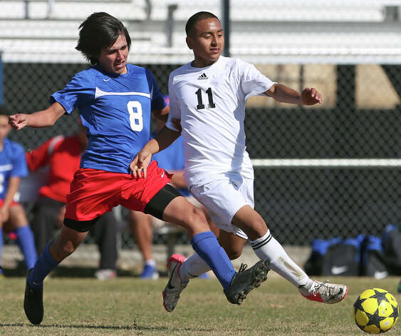 Jefferson's Miguel Hernandez races in and fouls Pedro Ibarra as Jefferson beats Edison 1-0 in soccer at the SAISD Spring Sports Complex on March 12, 2013. Photo: Tom Reel, San Antonio Express-News