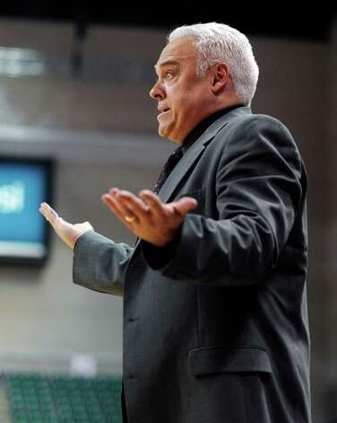 Texas State coach Doug Davalos questions a call during the second half of a Western Athletic Conference men's tournament NCAA college basketball game against Seattle, Tuesday, March 12, 2013, in Las Vegas. (AP Photo/David Becker) Photo: David Becker, Associated Press / FR170737 AP