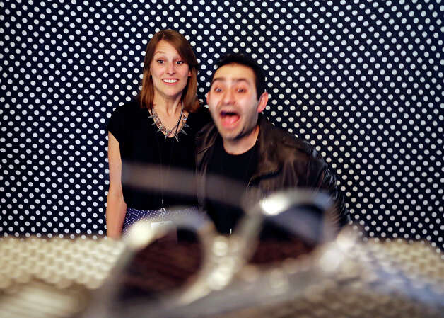 Emma Matthieson (left) and Rami Haykal pose for photos in the BKBooth during the #FEED powered by Twitter event held at the AMOA-Arthouse at the Jones Center during South by Southwest Tuesday March 12, 2013 in Austin, TX. Photo: Edward A. Ornelas, San Antonio Express-News / © 2013 San Antonio Express-News