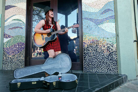 Karren Sager, from Nashville, Tenn, performs on 6th Street during South by Southwest Tuesday March 12, 2013 in Austin, TX. Photo: Edward A. Ornelas, San Antonio Express-News / © 2013 San Antonio Express-News