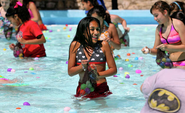 The chill of water bothers Alyssa Marin only a little as she gathers Easter eggs after Councilman Chris Medina pronounced the opening of Woodlawn pool for Spring Break on March 12, 2013. Photo: TOM REEL