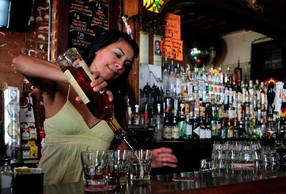 Jettav DeFilippis pours a round of bourbon shots at the Tempest bar and restaurant in San Francisco, Calif. on Tuesday, March 12, 2013. Sen. Mark Leno is introducing a bill in Sacramento that would allow bars to serve alcohol until 4 a.m. Photo: Paul Chinn, The Chronicle / ONLINE_YES