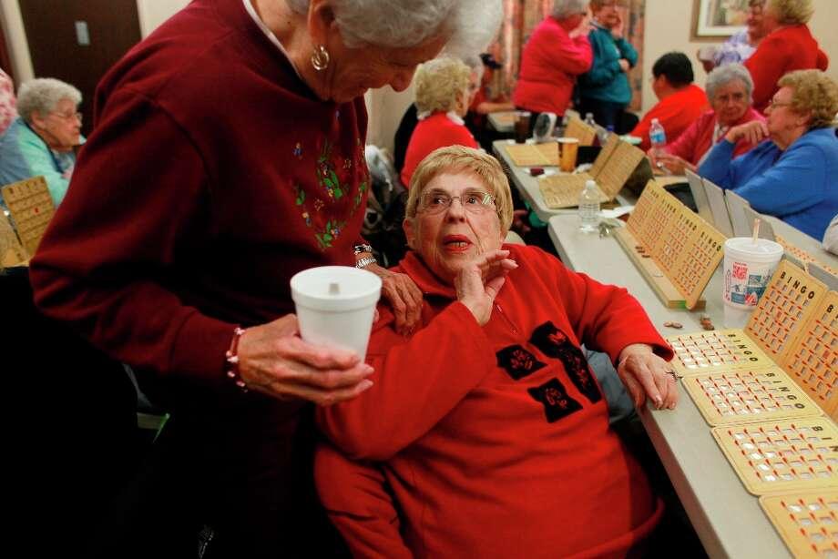 Marjorie McFadden, 91, (rt) says hello to Nancy Saldana in between bingo games at the Delhi Senior center on Wed. March 6, 2013 in Delhi, Calif. Photo: Mike Kepka, The Chronicle / ONLINE_YES