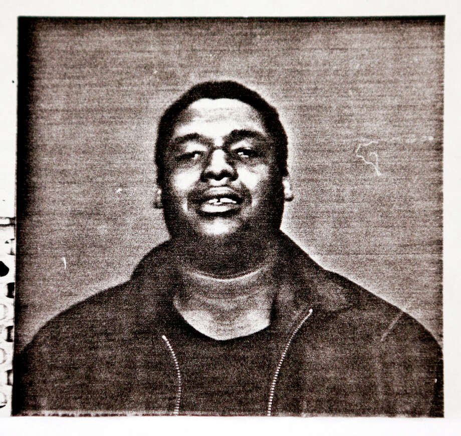 The original booking photo of Johnny Williams, of East Oakland, before serving 14 years in prison for a crime he was later exonerated for - Tuesday, March 12, 2013 in Santa Clara, Calif. Photo: Beck Diefenbach, Special To The Chronicle / ONLINE_YES