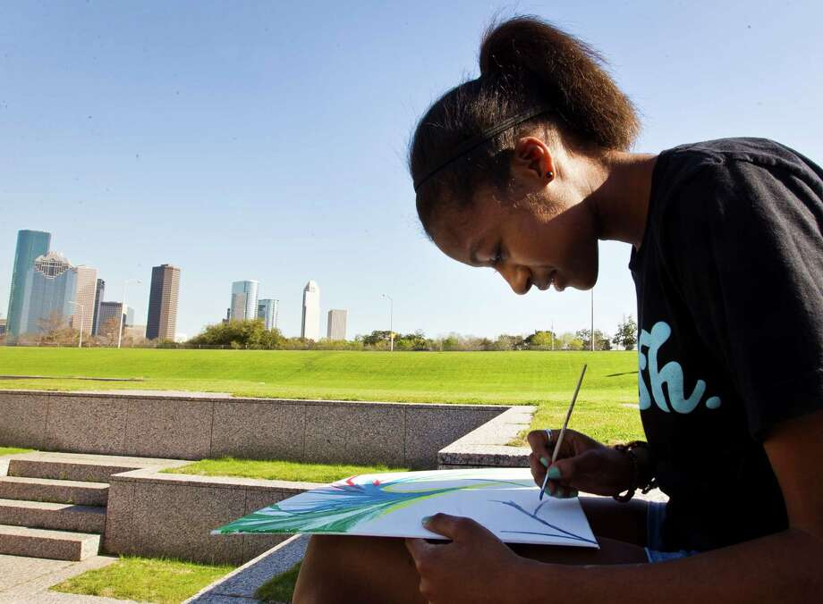 Kayla Richardson, 17, of Gilbert, Az., takes advantage of a nice day to paint at Houston Police Officers Memorial, Tuesday, March 12, 2013, in Houston. Photo: Nick De La Torre, Chronicle / © 2013 Houston Chronicle