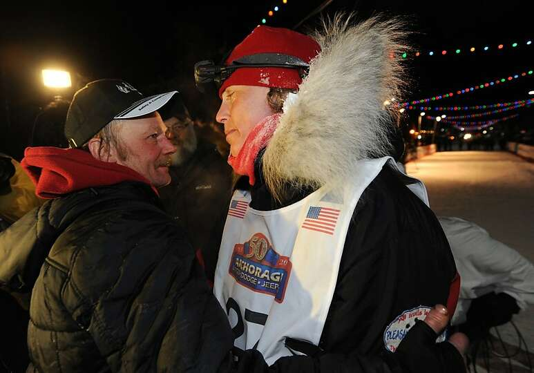 Mitch Seavey, left, became the oldest winner and a two-time Iditarod champion when he drove his dog