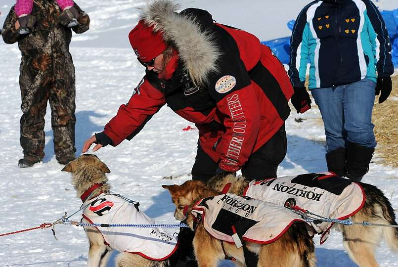Aliy Zirkle gets her dogs ready to leave White Mountain in Alaska, Tuesday, March 12, 2013, during t