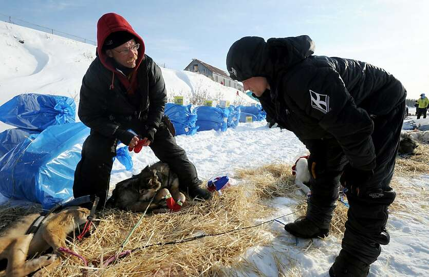 Mitch Seavey talks to his son Dallas in White Mountain, Alaska, Tuesday, March 12, 2013, during the