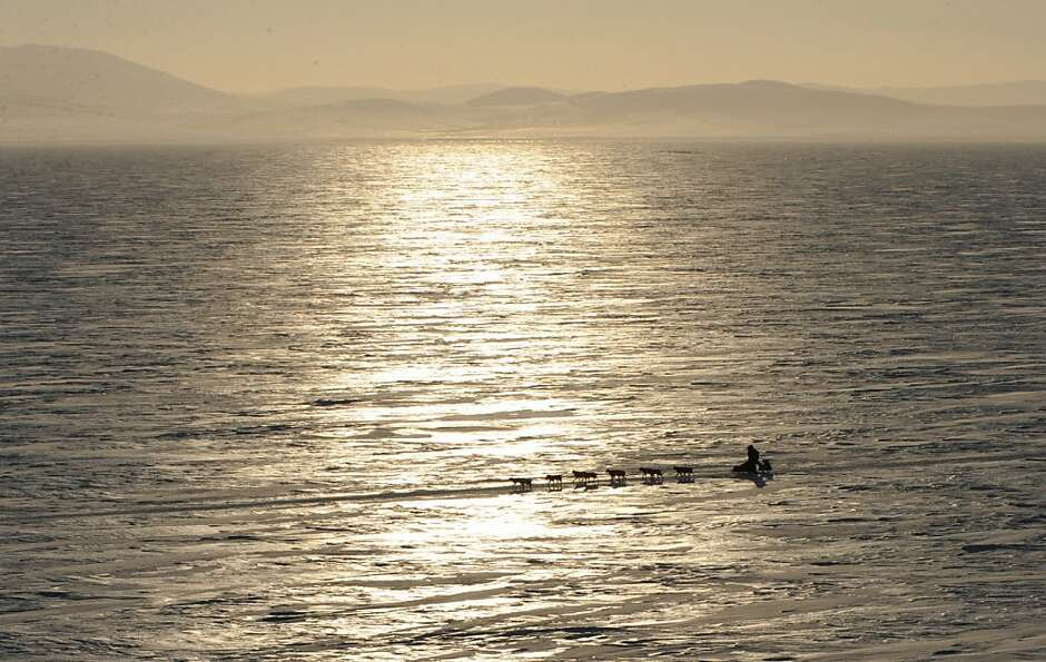 A musher travels across Norton Sound on their way to Koyuk in Alaska during the Iditarod Trail Sled
