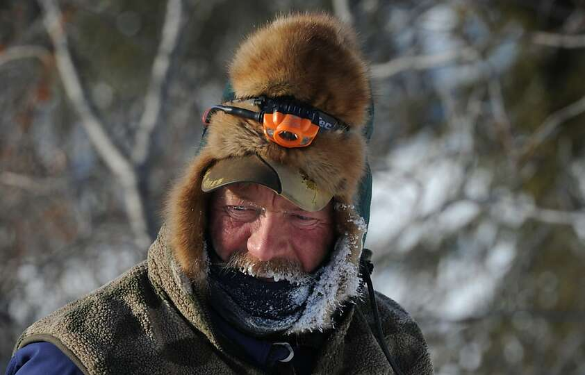 A frost covered Sonny Lindner begins his checkpoint routine in Koyuk in Alaska during the Iditarod T