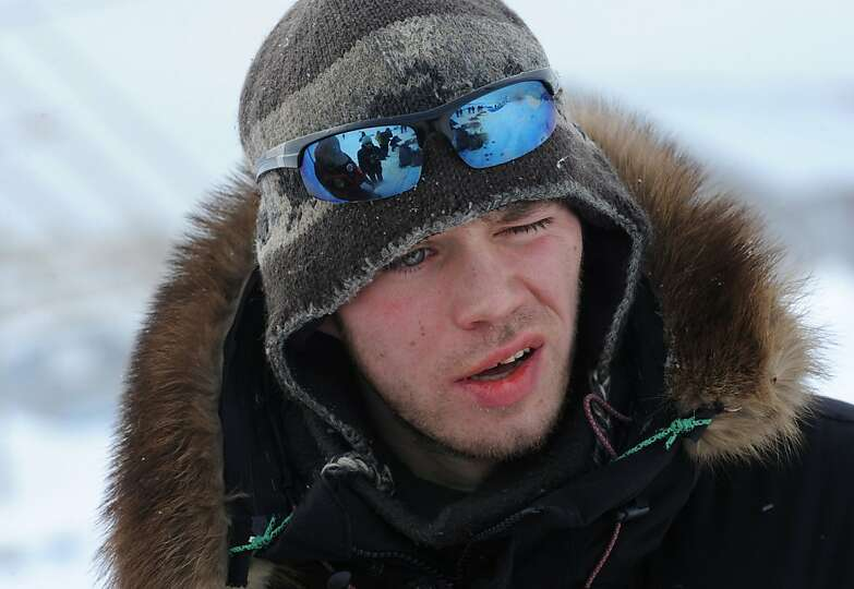 Norwegian musher Joar Leifseth Ulsom looks into the wind at his team after arriving in Unalakleet on