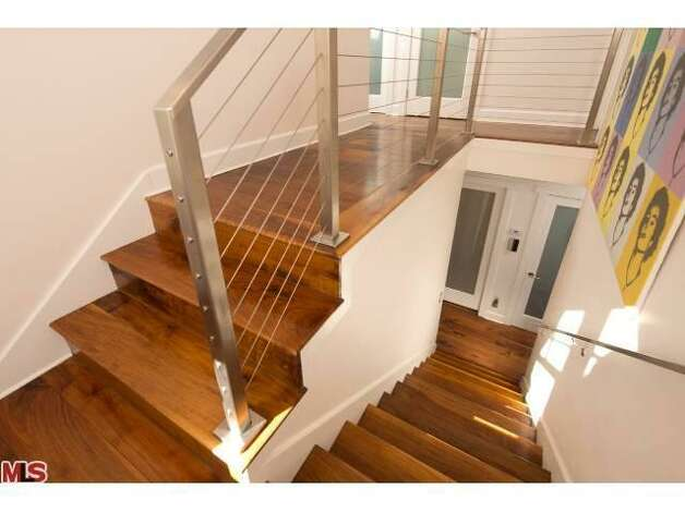 Wood stairwell with a modern steel railing.