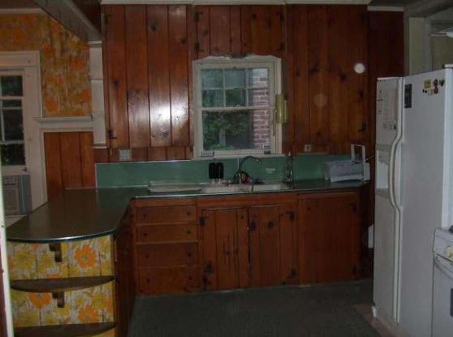 Very dated and dark kitchen