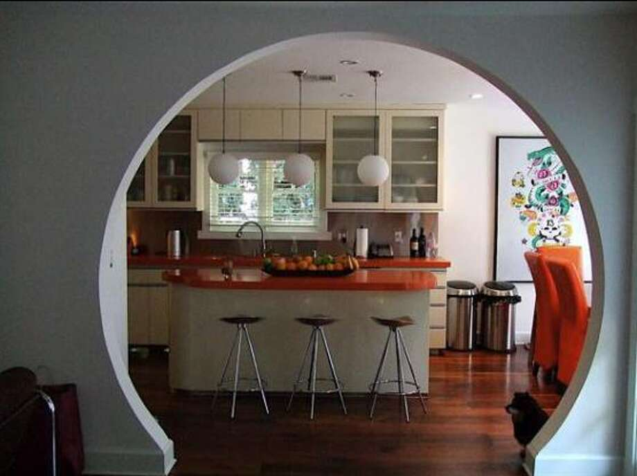 Bold orange beckons guests to the new kitchen
