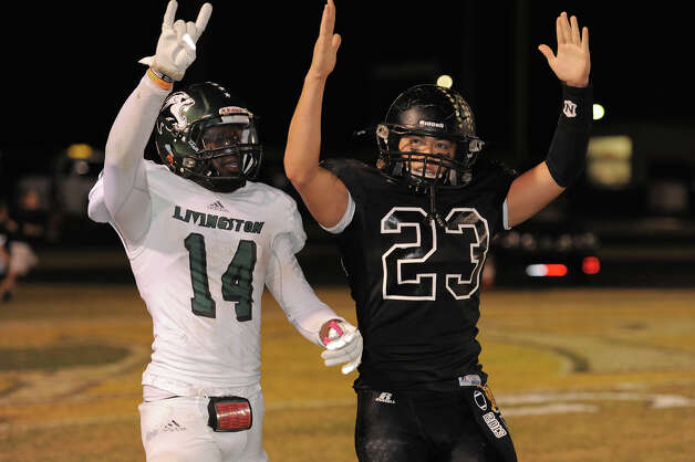 Vidor quarterback Montana Quirante celebrates a touchdown after holding off a last second tackle attempt by Livingston's Chevoski Collins. (Drew Locker, Special to The Enterprise) Photo: Drew Loker / 2012