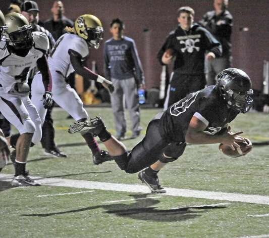 Vidor quarterback Montana Quirante, #23, is awarded Vidor's second touchdown of the game on this run.  The Vidor High School Pirates football team played the Humble Summer Creek Bulldogs at 7 p.m. Friday night at Clyde Abshier Stadium in Deer Park Texas. This is a Class 4A Division I first round game.  At the half, Humble Summer Creek was ahead 24-14. Dave Ryan/The Enterprise