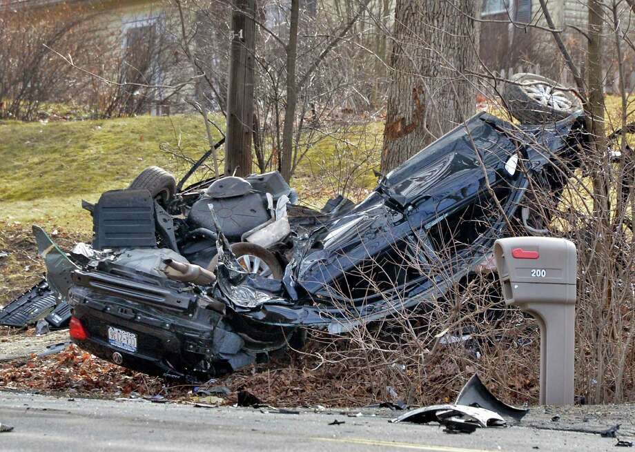 Aftermath of a car crash on Third Avenue at Grove Street in East Greenbush Wednesday March 13, 2013.  (John Carl D'Annibale / Times Union archive) Photo: John Carl D'Annibale / 00021553A