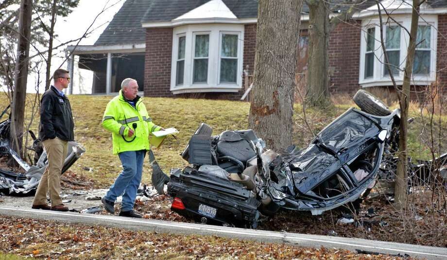 Police investigators from Rensselaer and East Greenbush at the scene of a car crash on Third Avenue and Grove Street in East Greenbush Wednesday March 13, 2013.  (John Carl D'Annibale / Times Union archive) Photo: John Carl D'Annibale / 00021553A