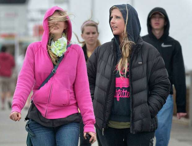 Spring breakers Laura Etheridge, left, and Taylor Jane from Mississippi walk down the windy Okaloosa Island Fishing Pier in Fort Walton Beach, Fla., Monday, March 11, 2013. Photo: Devon Ravine, Associated Press / Northwest Florida Daily News