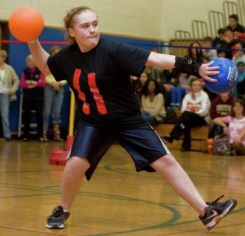 Bethel Middle School Seventh-grader Kayla Lucsky of the Black Raging Panthers team fires away in the dodgeball game called TigerBall at the Middle School. Tuesday, Mar. 12, 2013 Photo: Scott Mullin / The News-Times Freelance