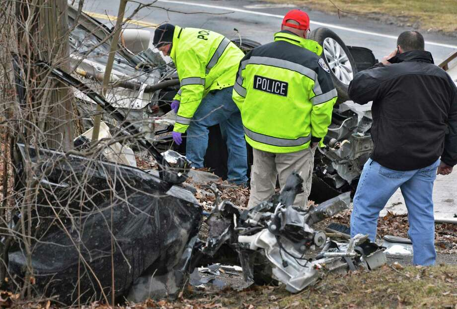 East Greenbush Police investigators at the scene of a car crash on Third Avenue and Grove Street in East Greenbush Wednesday March 13, 2013.  (John Carl D'Annibale / Times Union archive) Photo: John Carl D'Annibale / 00021553A