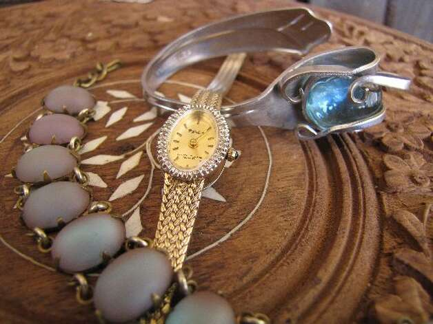 Fork bracelet, Urban Habitat, Beaumont, $20...Gold and rhinestone watch, Urban Habitat, Beaumont, $20...Vintage costume bracelet, Urban Habitat, Beaumont, $10. Larena Head/cat5