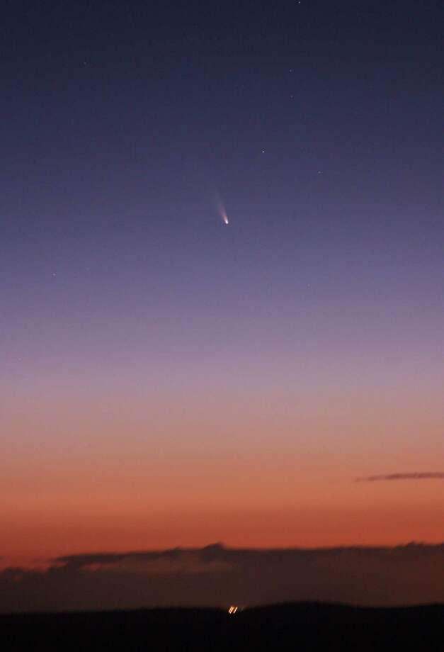 This image provided by NASA shoaws the comet PANSTARRS as seen from Mount Dale, Western Australia on March 5, 2013.  (AP Photo/NASA) Photo: Ap/getty