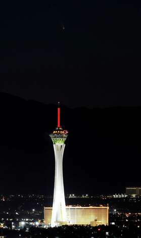 The comet PanSTARRS passes over the Stratosphere Casino Hotel on Tuesday, March 12, 2013 in Las Vegas, Nev. (Photo by Ethan Miller/Getty Images) Photo: Ethan Miller, Ap/getty / 2013 Getty Images