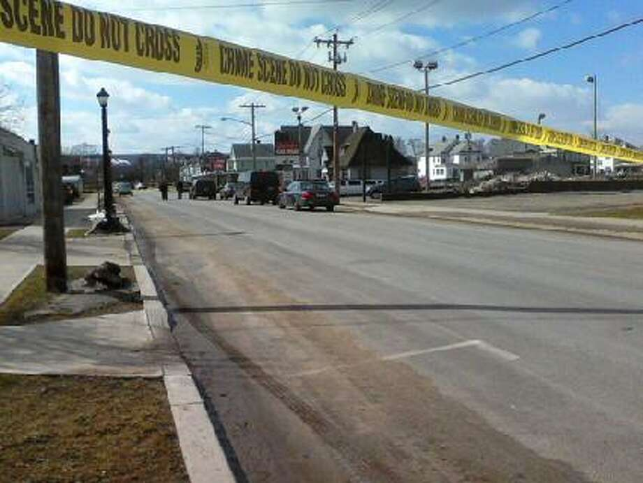 Police tape cordons off a street at the scene of shootings Wednesday, March, 13, 2013, in Herkimer, N.Y. Photo: Tim Blydenburgh, Times Union