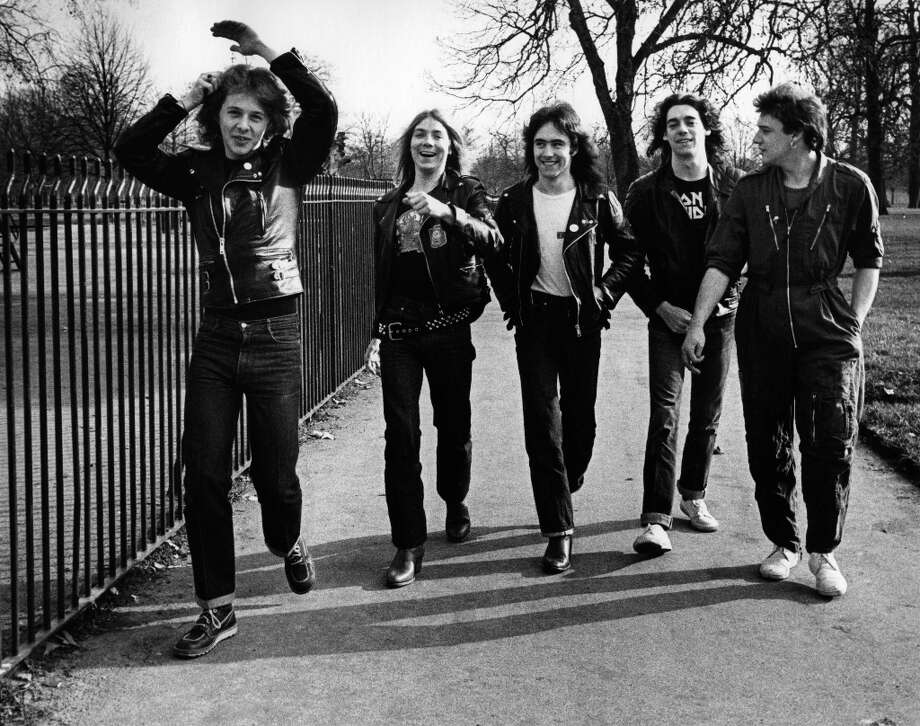 L-R: Clive Burr, Dave Murray, Steve Harris, Dennis Stratton, Paul Di'Anno - posed, group shot, walking through park Photo: Virginia Turbett, Redferns / Redferns