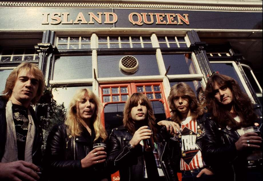 English heavy metal group Iron Maiden outside the Island Queen pub in Islington, London, 1982. Left to right: guitarist Adrian Smith, guitarist Dave Murray, singer Bruce Dickinson, drummer Clive Burr and bassist Steve Harris. Photo: Michael Putland, Getty Images / 2009 Getty Images