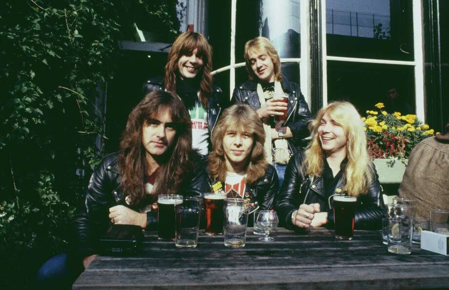 English heavy metal group Iron Maiden outside the Island Queen pub in Islington, London, 1982. Back row, left to right: singer Bruce Dickinson and guitarist Adrian Smith. Front row, left to right: bassist Steve Harris, drummer Clive Burr and guitarist Dave Murray. Photo: Michael Putland, Getty Images / 2012 Michael Putland
