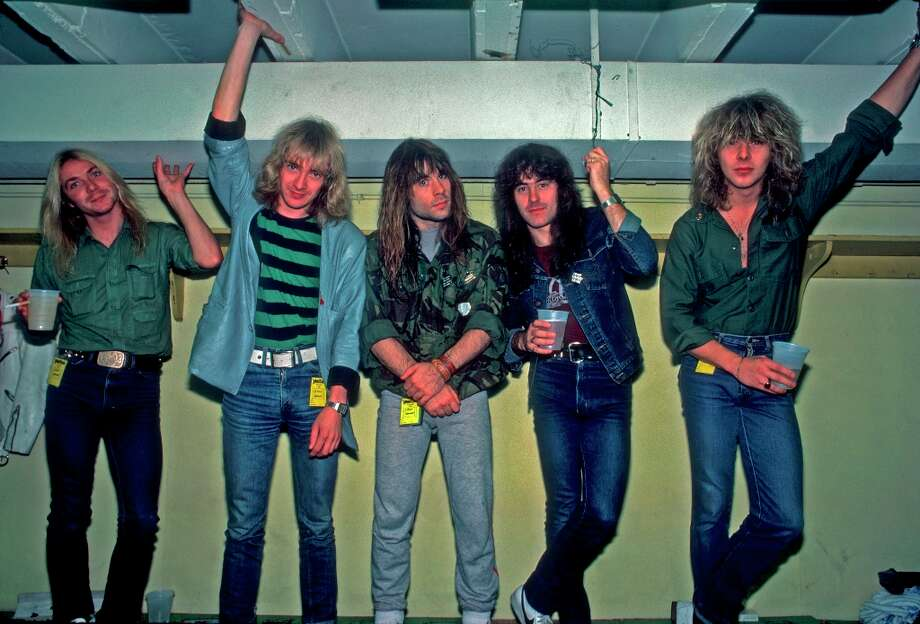 Portrait of British heavy metal band Iron Maiden backstage at the Rosemont Horizon during their Beast on the Road Tour, Chicago, Illinois, September 21, 1982. Pictured are, from left, Dave Murray, Adrian Smith, Bruce Dickinson, Steve Harris, and Clive Burr. Photo: Paul Natkin, Getty Images / Archive Photos