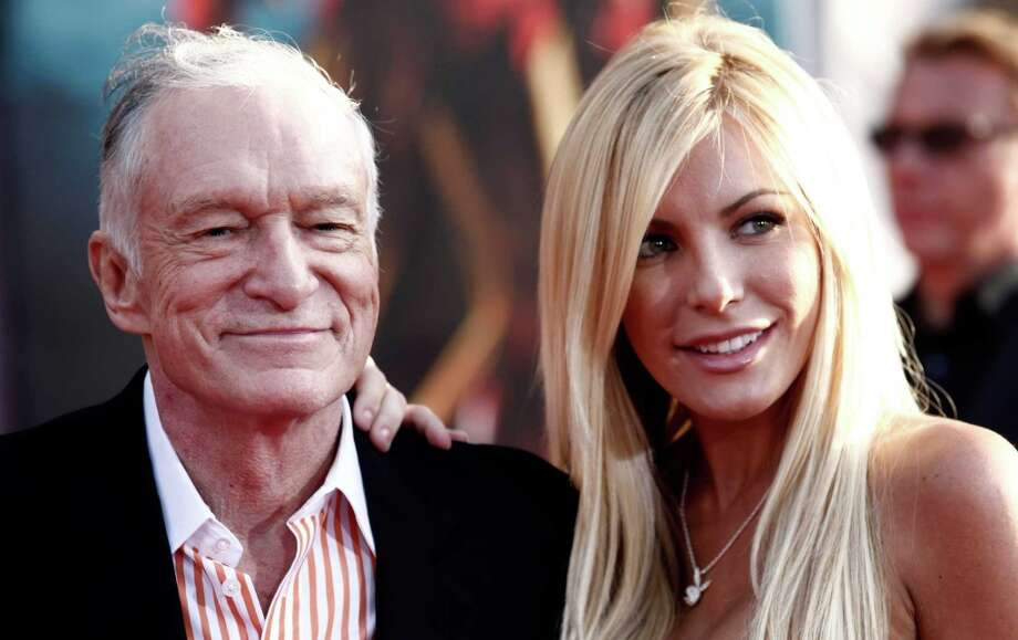 Love knows no bounds, right? Not even a 60-year age difference? For proof, look no further than the New Year's Eve wedding of Hugh Hefner, 86, and runaway bride Crystal Harris, 26.  The wedding came a year after the Playmate broke off the couple's  previous engagement plans in 2011. Here's a look at the newlyweds and other famous oldster-babe pairs. (AP Photo/Matt Sayles) Photo: AP / AP