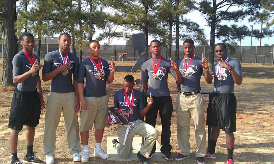 Josh Thomas, Chris Fowler, Donovan Middleton, LeDale White, Daniel Adams, Jonavon Limbrick, and Kendall Shankle.  Several members of the track team pose with the Indian Relays Championship Trophy infront of the late Coach Lloyd Weatherspoon memorial at the JHS practice track. Photo: Courtesy Photo