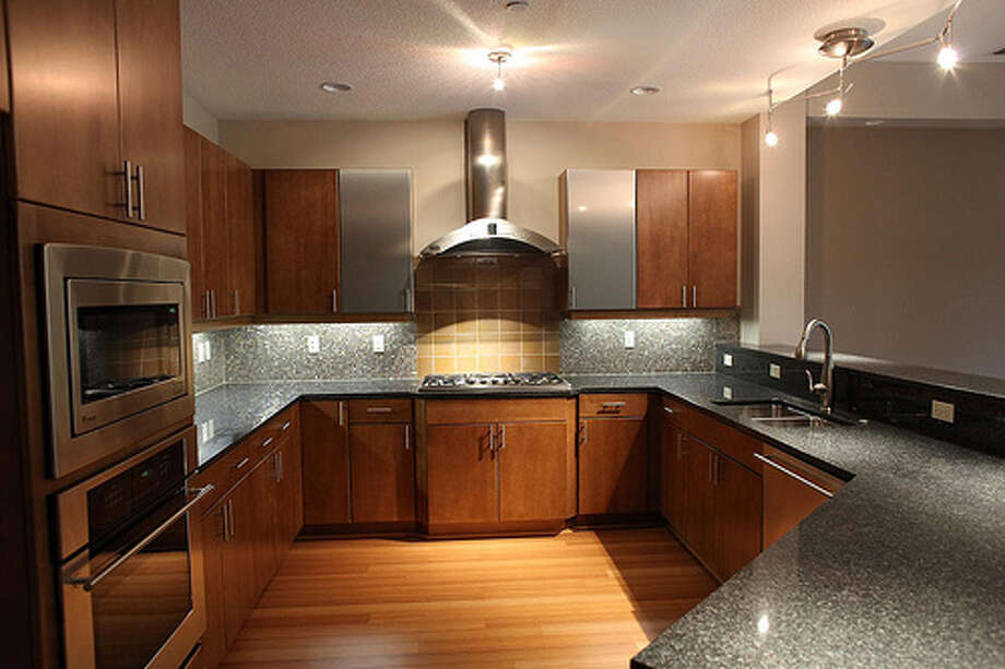 Upgrade your kitchen: Kitchens are turning into a key feature for prospective home buyers. An inviting kitchen with updated appliances can improve your home's value quickly. Photo: Art History Images, Flickr