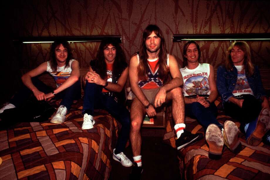 Portrait of British heavy metal band Iron Maiden in an hotel room before a show at the Holiday Star Theater during their Beast on the Road Tour, Merrillville, Indiana, May 25, 1982. Pictured are, from left, Clive Burr, Steve Harris, Bruce Dickinson, Adrian Smith, and Dave Murray. Photo: Paul Natkin, Getty Images / Archive Photos