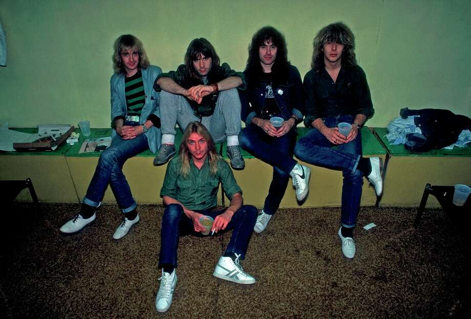 Portrait of British heavy metal band Iron Maiden backstage at the Rosemont Horizon during their Beast on the Road Tour, Chicago, Illinois, September 21, 1982. Pictured are, from left, Adrian Smith, Bruce Dickinson, Dave Murray (on floor), Steve Harris, and Clive Burr. Photo: Paul Natkin, Getty Images / Archive Photos
