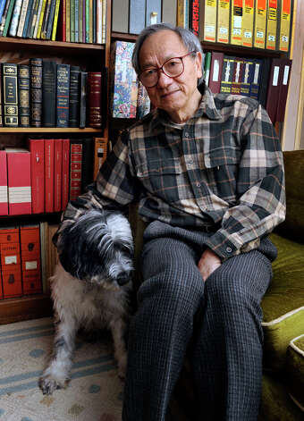 Dr. Phillip K. Lu, of Bethel, Conn., a retired professor of astronomy and astrophysics, recently published a book of poetry. Born in China to a peasant family, he left home at 12 to find work, and came to the United States 50 years ago. He is photographed in his home Tuesday, March 12, 2013. Photo: Carol Kaliff / The News-Times