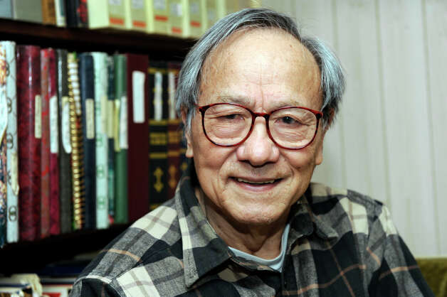 Dr. Phillip K. Lu, of Bethel, Conn., a retired professor of astronomy and astrophysics, recently published a book of poetry. Born in China to a peasant family, he left home at 12 to find work, and came to the United States nearly 50 years ago. He is photographed in his home Tuesday, March 12, 2013. Photo: Carol Kaliff / The News-Times