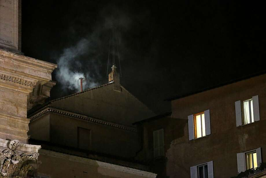 VATICAN CITY, VATICAN - MARCH 13:  White smoke billows from the chimney on the roof of the Sistine Chapel indicating that the College of Cardinals have elected a new Pope on March 13, 2013 in Vatican City, Vatican.  (Photo by Peter Macdiarmid/Getty Images) Photo: Peter Macdiarmid, Getty Images