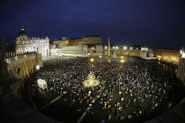 Crowds gather in St. Peter's Square to wait for the election of a new pope by the cardinals in conclave in the Sistine Chapel at the Vatican, Wednesday, March 13, 2013. (AP Photo/Andrew Medichini) Photo: Andrew Medichini, Associated Press