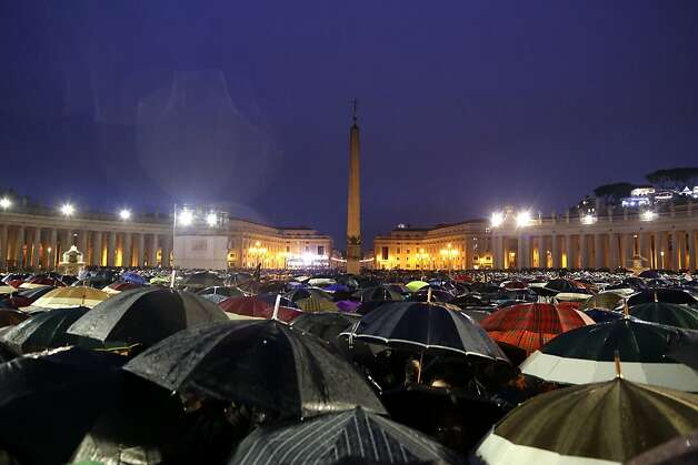 VATICAN CITY, VATICAN - MARCH 13:  People shelter from the rain in St. Peters Square as they await news of the newly elected Pope on March 13, 2013 in Vatican City, Vatican. Pope Benedict XVI's successor, the 266th Pontiff, has been selected by the College of Cardinals in Conclave in the Sistine Chapel.  (Photo by Franco Origlia/Getty Images) Photo: Franco Origlia, Getty Images